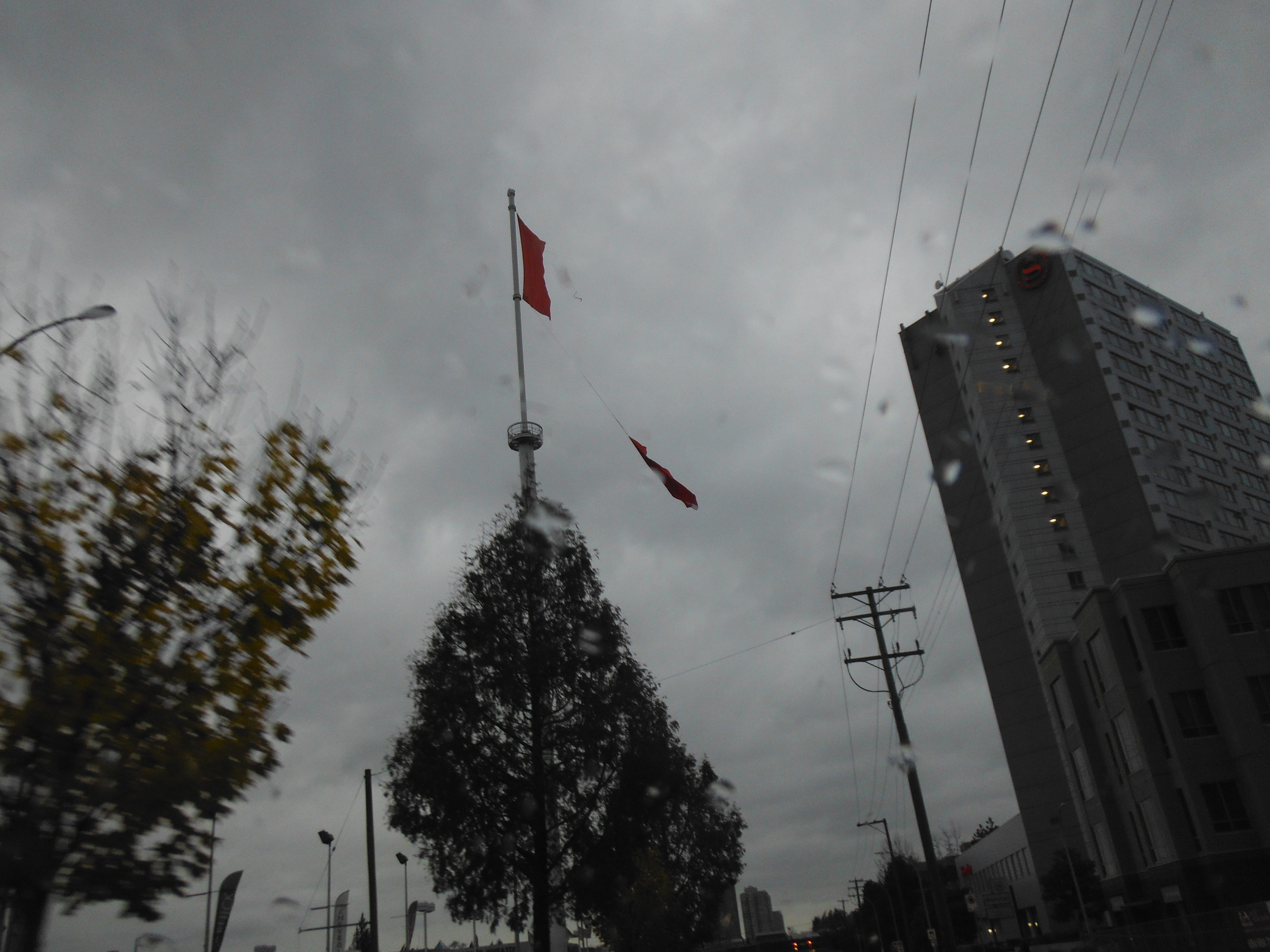 Ripped Canadian Flag flies over Surrey
